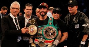 Jorge Linares with boxing belts