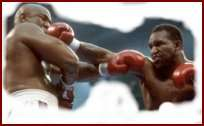 fight This Month in Boxing History: April 1991  Evander Holyfield vs. George Foreman.