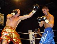 thumb Thomas McDonagh launches a big left at Darren Rhodes14 Boxing Photos: Barnes vs Hare and Undercard